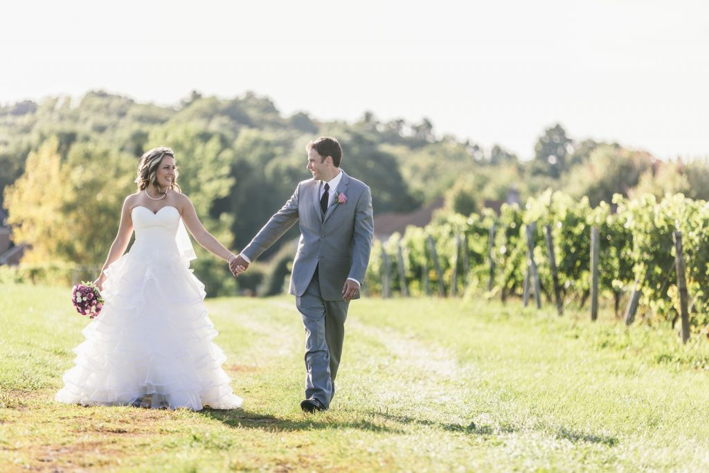 Bride and groom in the vineyard, Wedding Ceremonies and Receptions at Casa Larga Vineyards