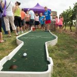 Play a mini game of golf while you wait for the vineyard hayrides