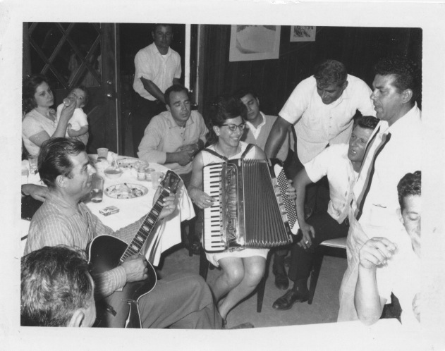 Mrs. Colaruotolo playing the accordion with friends and family, Casa Larga Vineyards