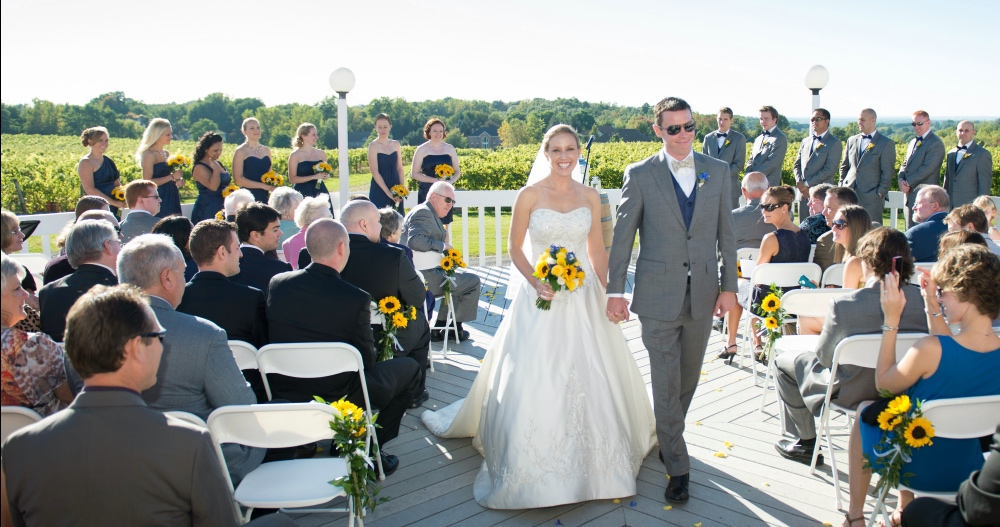 Bride and groom walking down aisle, Patio Ceremony, Wedding Receptions and Ceremonies at Casa Larga Vineyards