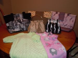 Handbags and clothing goods from Joan!