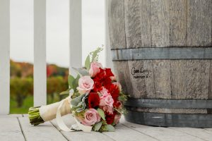 Bouquet of Flowers and Casa Larga Wine Barrel on Patio, Weddings at Casa Larga Vineyards