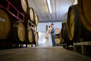 Couple in the Cellar, Wedding Ceremonies and Receptions at Casa Larga Vineyards