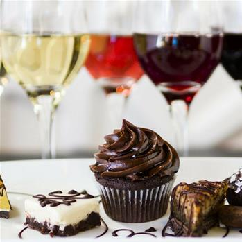 Cupcakes and sweets with varying glasses of wine